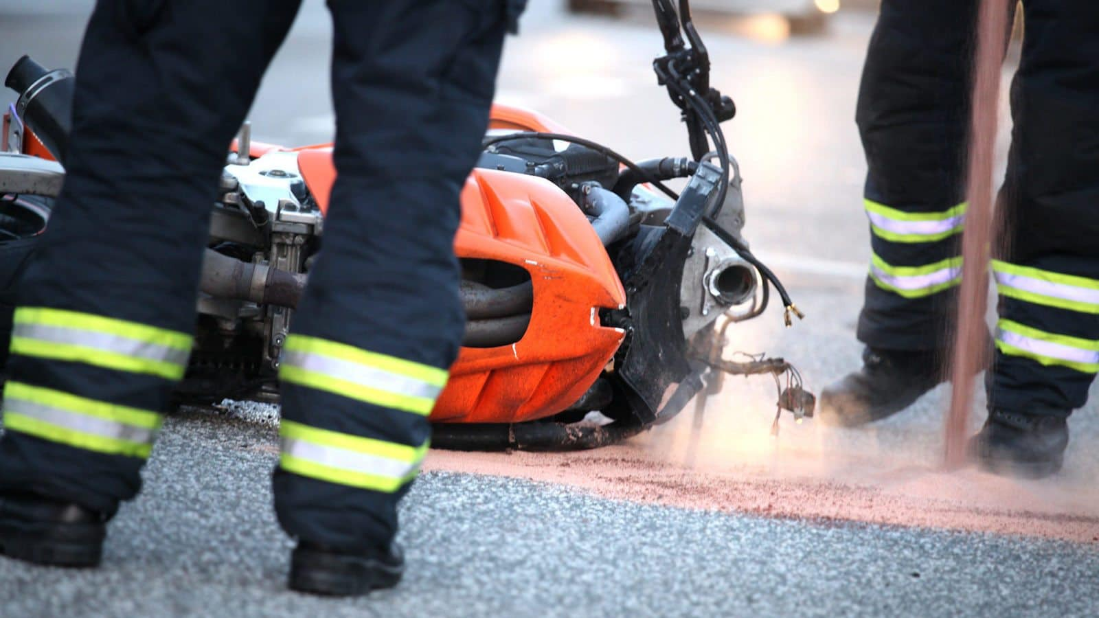 motorcycle accident with EMTs on the scene