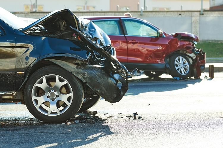 car crash accident. Car collision on city street. Two damaged automobiles