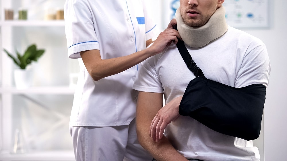 Man receiving medical care after a car accident