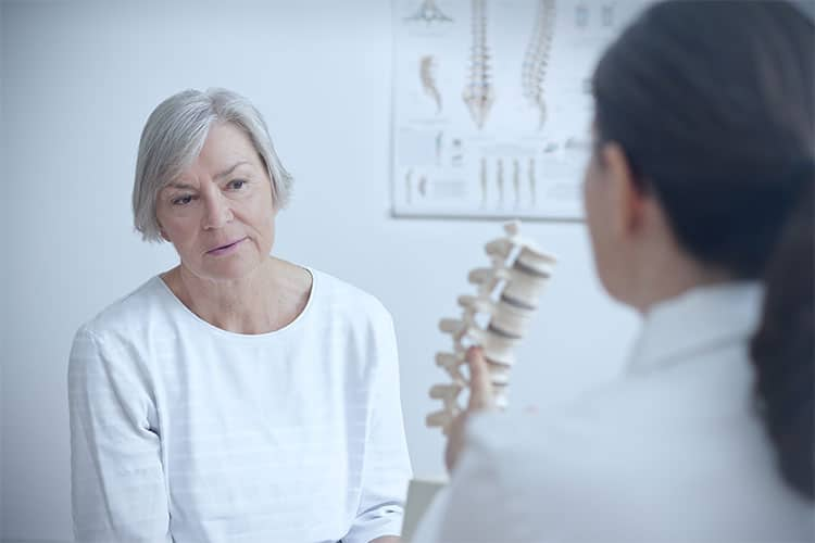 Doctor and patient discussing quality of life after spine surgery